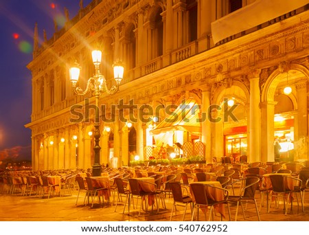 Square San Marco and street cafe tables at night, Venice, Italy