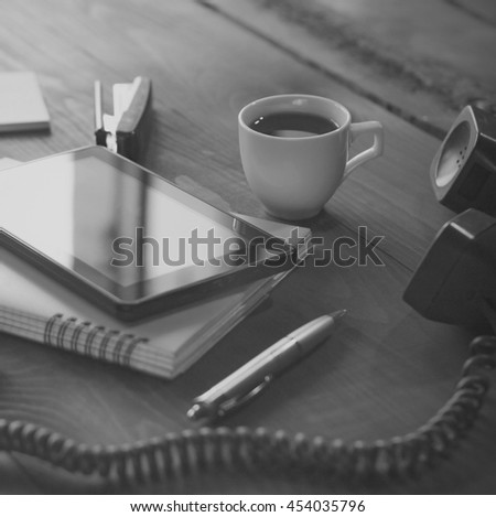 square shot. black and white photo. Flat lay, Layout workplace freelancer. Tablet PC notebook open, pen, watches glass of clean water. Work from home or Work outside the office. Top view, closeup