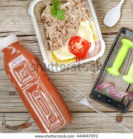 Square shot. Closeup of a Smartphone and wholesome food in disposable containers on a wooden background, Concept: Proper nutrition, catering, business lunch, shopping online. - stock photo
