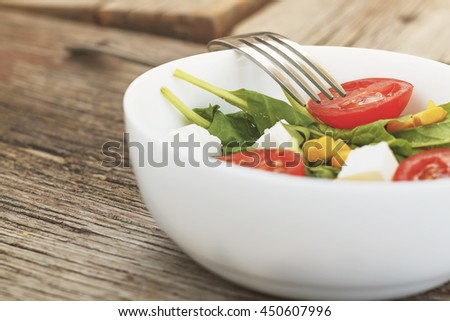 Square shot. Closeup of a Smartphone and wholesome food in disposable containers on a wooden background, Concept: Proper nutrition, catering, business lunch, shopping online.