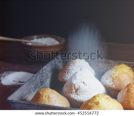 Square shot. Female baker or pastry chef sprinkles powdered sugar. motion blur, selective focus. Closeup. Selective focus, bakery products. cakes, muffins. vintage, closeup
