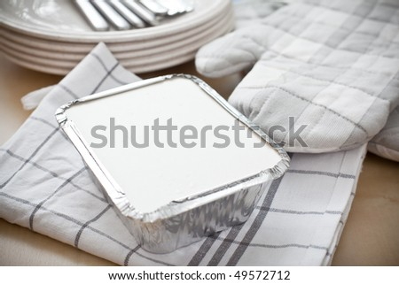 Square silver foil tray with lid on - stock photo