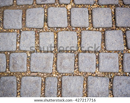 Square stone rock pattern on the floor - stock photo