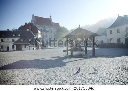 square with a church in Kazimierz Dolny - stock photo
