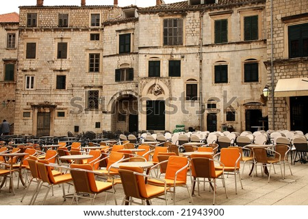 Square with restaurants  in Croatia, Dubrovnik after season. Famous city fortress on the Adriatic. - stock photo
