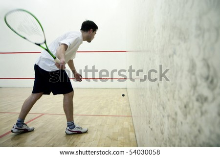 Squash player in action - stock photo