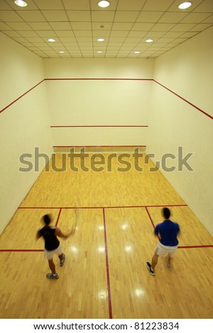 Squash room with player - stock photo