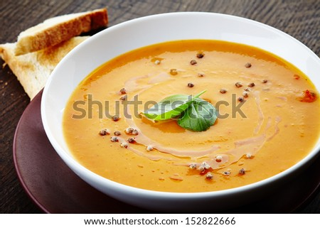 squash soup with basil leaf and spices - stock photo