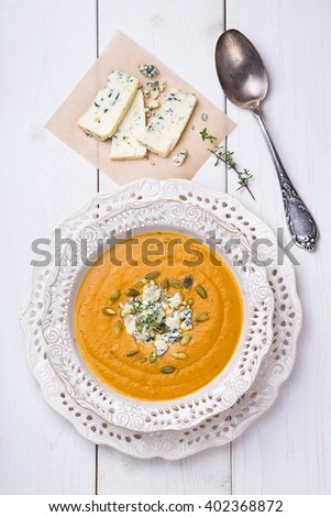 Squash Soup with Blue Cheese and Thyme on White Background top view - stock photo