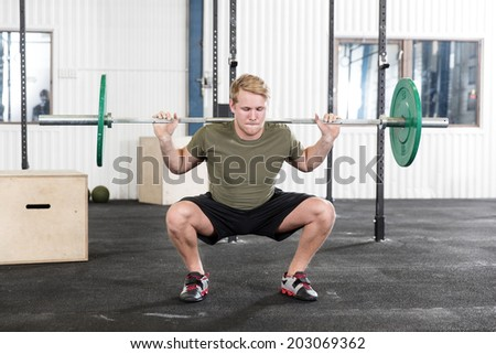 Squats training at fitness gym center - stock photo