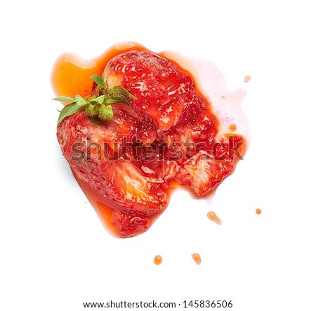 squeezed strawberry stain on white background - stock photo