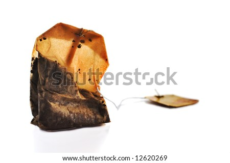 Squeezed tea bag on white background - stock photo