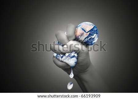 Squeezing the Earth - stock photo
