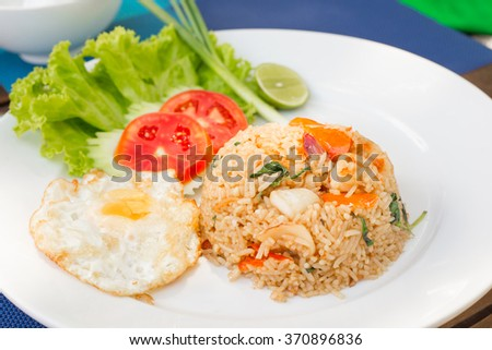 Squid and shrimp fried rice egg and vegetables, thai food. - stock photo