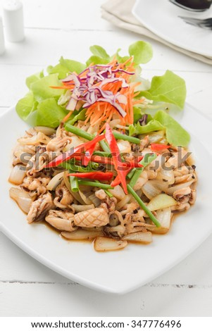 squid. Chinese stir-fried squid with black pepper , garlic and soy sauce asia food - stock photo