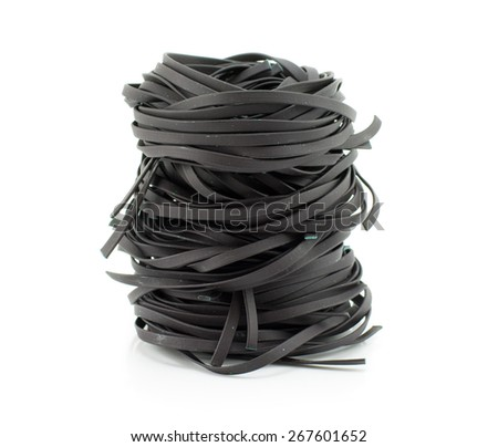 Squid ink black tinted twirl of a tagliatelle - stock photo