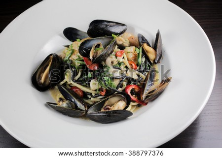 Squid ink pasta with mussels, shrimp and chilis