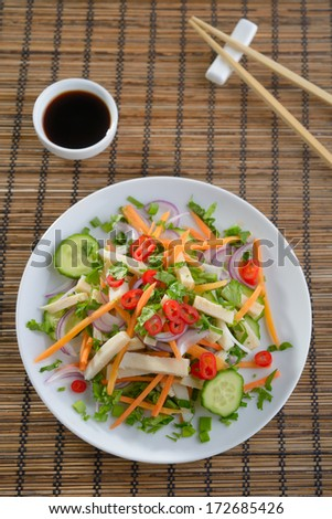 Squid salad with carrot, onion, cucumbers, chili peppers, and soy ...