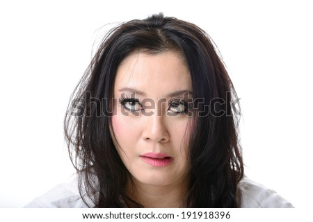 squint eyed crazy woman isolated on white - stock photo
