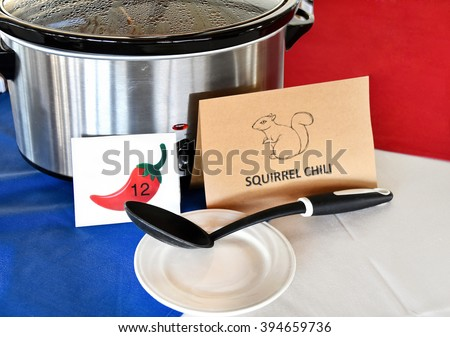 squirrel chili in crock pot with sign for chili cook off contest in restaurant - stock photo