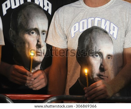 SREMSKA RACA, SERBIA - AUGUST 4, 2015: Mourners hold lightened candles during remembering procession for victims of Yugoslav civil war, on August 4th, 2015 in Sremska Raca, Serbia - stock photo