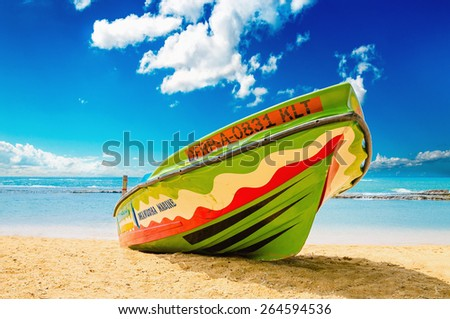 SRI LANKA, BERUWALA - JANUARY 9, 2015: Colourful boat on the background of the endless sea and a beautiful sandy beach