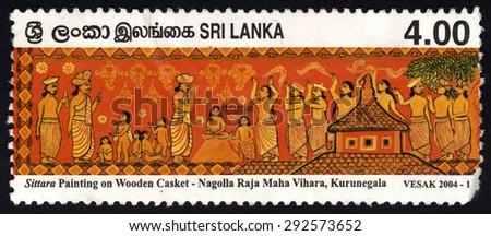 SRI LANKA - CIRCA 2004: A stamp printed in Sri Lanka shows Vesak 2004 (Painting from Panels in Nagalla Temple Kurunegala), circa 2004 - stock photo