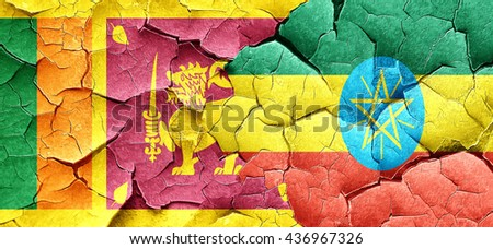 Sri lanka flag with Ethiopia flag on a grunge cracked wall - stock photo