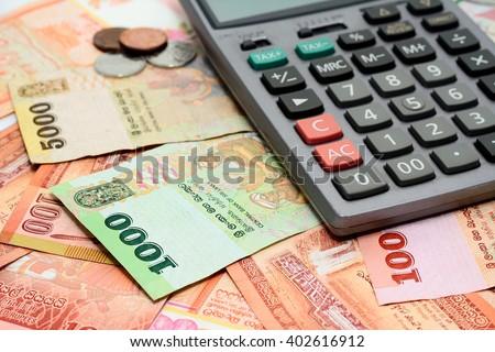 Sri Lanka money Rupee, banknote 100,500,1000,5000 LKR and calculator - stock photo