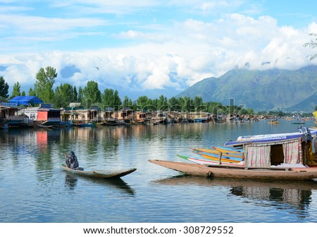 SRINAGAR, INDIA - JUL 21, 2015. Lifestyle in Dal lake, an Indian man using a small boat for transportation in the lake of Srinagar, Jammu and Kashmir state, India.