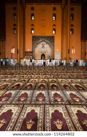 SRINAGAR, INDIA - JULY 11: Muslims gather for evening prayer in the prayer hall at the Main Mosque, Jama Masjid, a major tourist attraction, in Kashmir on July 11, 2009 in Srinagar, India. V - stock photo