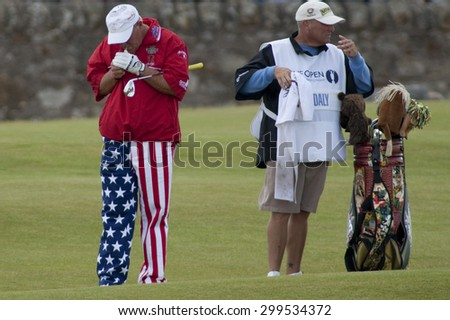 ST ANDREWS, SCOTLAND. July 18 2010: John DALY from the USA lights up a cigarette  during the final round of The Open Championship   played on The Royal and Ancient Old Course - stock photo