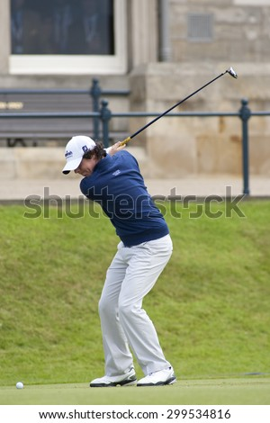 ST ANDREWS, SCOTLAND. July 17 2010: Rory McILROY from Northern Ireland in action during the third round of The Open Championship   played on The Royal and Ancient Old Course - stock photo