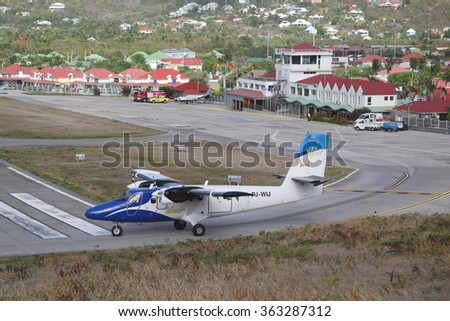 ST. BARTHS, FRENCH WEST INDIES -JUNE 13, 2015:  Winair DHC-6 aircraft ready to take off at St Barths airport. Windward Islands Airways celebrating 50 years of service.