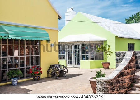 ST.GEORGE,BERMUDA, MAY 27 - Colorful style architecture and white roof shops of St. George are typical of the island on May 27 2016 in Bermuda. - stock photo