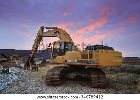 St George, UT - October 28, 2015: A John Deere construction excavator at sunrise. - stock photo
