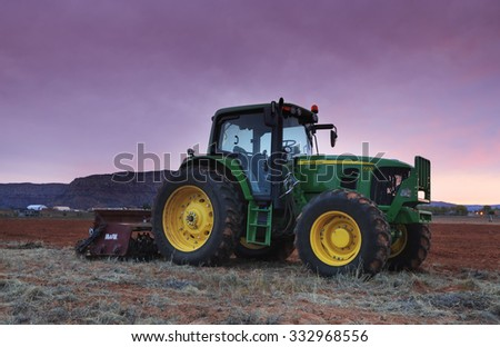 St George, UT - October 28, 2015: A John Deere farm tractor at sunrise. - stock photo