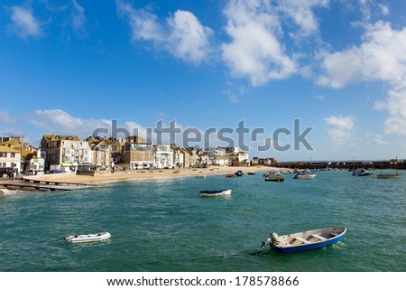St Ives Cornwall England with harbour boats and blue sea and sky a traditional Cornish fishing town in the UK - stock photo