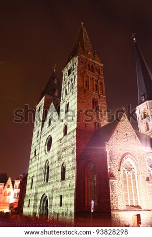 St. Jacobskerk in Ghent, Belgium, during the festival of lights. Portuguese mosaic on the building projected - stock photo