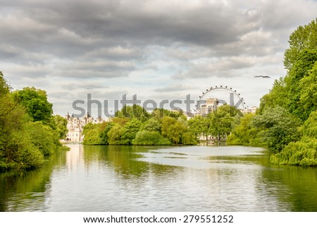 St. James park at London. Beautiful cityscape from a green park and with the London Eye in the background. - stock photo