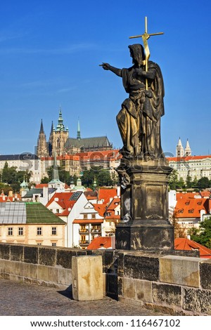 St. John the Baptist, view of the Cathedral of St. Vitus. Charles Bridge in Prague. - stock photo