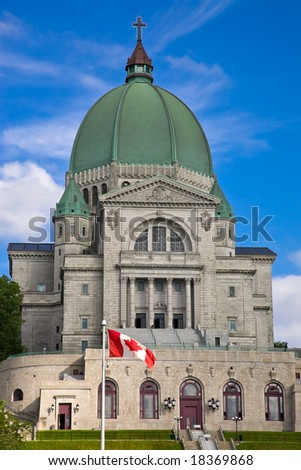 St.Joseph Oratory with Canadian flag in front of it, Montreal, Canada - stock photo