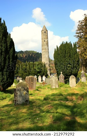 St. Kevin's Monastery, Glendalough, County Wicklow, Ireland - April 29: Old mediaval monastery at Glendalough in Ireland on April 29, 2014  - stock photo
