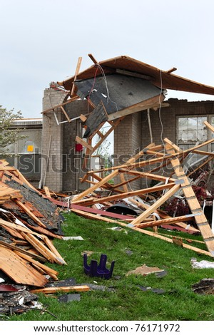 ST. LOUIS - APRIL 25, 2011: Precarious remnants of a house stand in testament to the fierce tornado that swept through Maryland Heights in the suburbs of St. Louis on Good Friday, April 22, 2011. - stock photo