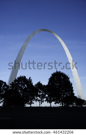 St. Louis Arch with Blue Sky and Silhouette of Trees.