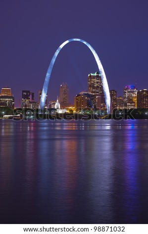 St. Louis Gateway Arch reflecting in the Mississippi River - stock photo