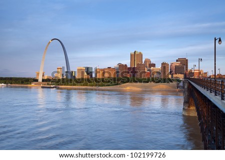 St. Louis. Image of St. Louis downtown with Gateway Arch at sunrise. - stock photo