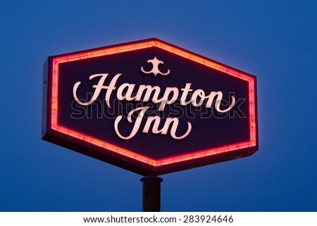 ST. LOUIS, MISSOURI - MAY 28: Hampton Inn sign at twilight on May 28, 2015 in Collinsville, Illinois - stock photo