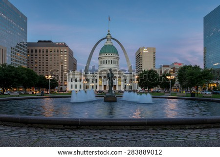 ST. LOUIS, MISSOURI - MAY 27: Kiener Plaza with the Running Man statue and the Old Courthouse and the Arch on May 27, 2015 in St. Louis, Missouri