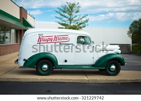 ST. LOUIS, OCT. 5: Krispy Kreme classic truck classic car in front of store in St. Louis, Missouri on October 5, 2014. Krispy Kreme was founded on July 13, 1937 by founder Vernon Rudolph. - stock photo